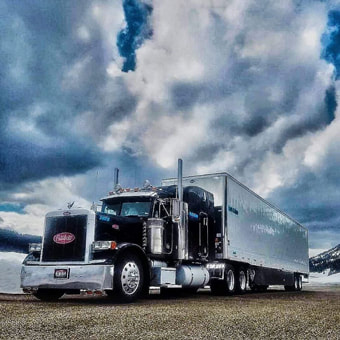 GLS Carriers - Dry van freight shipping solutions - black peterbilt with white trailer